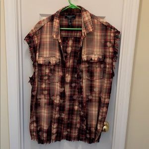 Awesome distressed sleeveless flannel